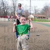 Tribune-Star/Rachel Keyes<br /> Big push: Mother Jessica Kuhn gives her son Freddy Kuhn a big push on a swing at Deming Park Monday afternoon.