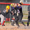 Tribune-Star/Jim Avelis<br /> Interference: Brave Kelsey Marlow(17) is caught off base by Warrior Kara Repp(10), but Marlow was safe on the play due to an interference call.