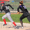 Tribune-Star/Jim Avelis<br /> Caught: Brave baserunner Rebecca Latta(16) is caught in a rundown by Casey shortstop Kara Repp(10).