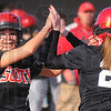 Tribune-Star/Jim Avelis<br /> In a pinch: Dana Hedden replaces teammate Marissa Stout(21) as a pinch runner in teh Braves game with Casey Monday evening.