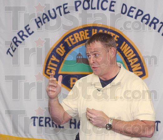 Tribune-Star/Jim Avelis<br /> Top finisher: Terre Haute police Sgt. Jason Brentlinger announces that Terre Haute was voted the fouth best host for a National Night Out event last year.