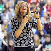 Publisher: Tanglewood Press publisher Peggy Tierney talks with Honey Creek Middle School students during an assembly in the school gym Tuesday morning.