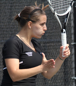 Senior Rita Gouveia plays in a singles match on March 19th, 2011 against an opponent from Pfeiffer University.