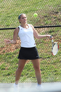 Junior Ioana Oprea returns a serve against a Pfeiffer University opponent on March 19th, 2011.