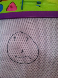 Gralyn started drawing faces!