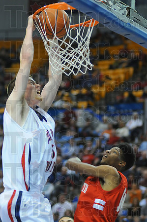 Sure two: Patriot Justin Gant dunks over Terre Haute South's Jermaine Smith.