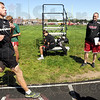 Coach: South track coach Mark Raetz (R) watches Logan Hambrock finish part of his Monday evening workout as the team prepares for sectionals.