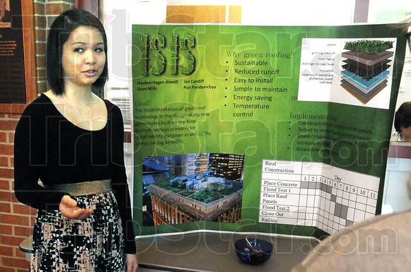 Solutions: Rose-Hulman student Pun Pasidparchya gives her presentation Thursday morning in Hadley Hall.