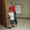 Tribune-Star/Jim Avelis<br /> All mine: Cayden Hecklesberg opens the closet door in his bedroom in the families' new home on Eagle Street. His mom Jackie Nevis is with him on their tour of the home.