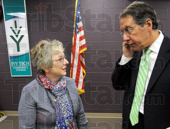 Tech talk: Ann Valentine speaks with Tom Snyder after being introduced as Chancellor.