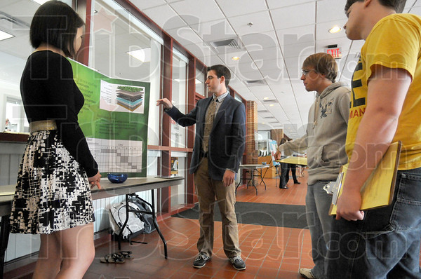 Presentation: Students (from left), Pun Pasidparchya, Ian Cundiff, Matt Busscher and Andrew Bower participate in the Rose-Hulman Look at Sustainable Solutions for Campus event Thursday morning.