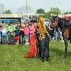 Arabian: Sheryl Adamson and four-year-old Aubrey Summers show their arabian horse to a group of Fuqua Elementary School children Thursday morning at Regional Hospital.