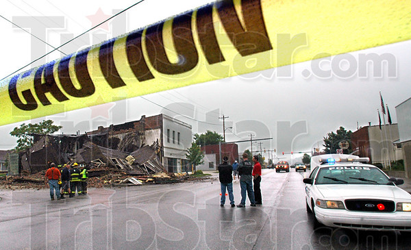 Caution: Caution tape surrounds the intersection of 6th Street and National Avenue in West Terre Haute after the building on the southwest corner collapsed Thursday afternoon.
