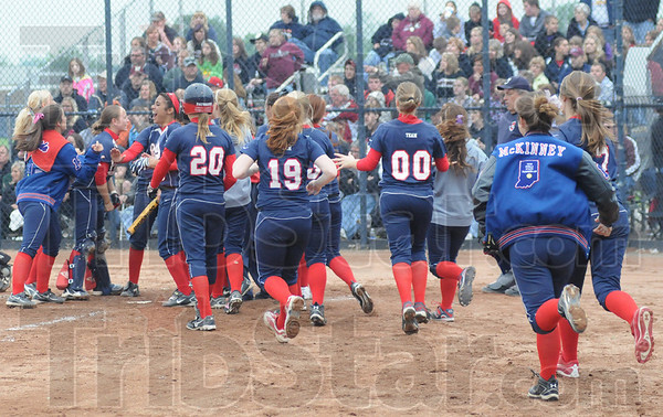 Tribune-Star/Rachel Keyes<br /> Time to celebrate: Terre Haute North clears the dugout in celebration at Friday's sectional.