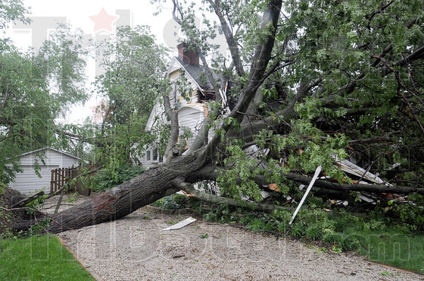 Damaged: A home at 2920 N. 11th street was heavily damaged by a falling tree Thursday.