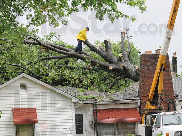 Destroyed home: A home owned by Councilman Jim Chalos was destroyed by a tree falling through the roof during overnight storms.