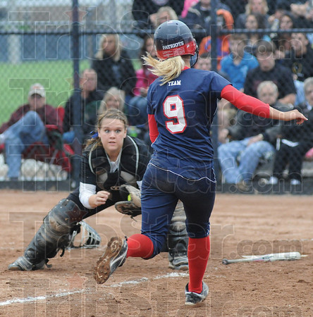 Tribune-Star/Rachel Keyes<br /> Hold: Northview's Catcher Jessica LaTourette holds her ground at home plate to tag Terre Haute North's Paige Collins out in late innings Friday night.
