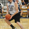 Tribune-Star/Rachel Keyes<br /> Driving for a cause: Justin Gant drives the lane in a charity game he hosted Friday night at Terre Haute North.
