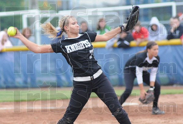 Tribune-Star/Rachel Keyes<br /> Strong arm: Northview's pitcher Taylor Carter prepares to throw a strike at the plate in action Friday.