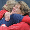 Tribune-Star/Rachel Keyes<br /> Biggest fan: Hail Travail (left) gets a hug from her biggest fan her mom Tracy Travail (right) after hitting a home run that put Terre Haute North up by one in the sixth inning of sectional play Friday.