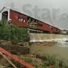 Tribune-Star/Rachel Keyes<br /> Blown away: Pieces of the Bridgeton Bridge lay in the creek below after Wednesday's storm.