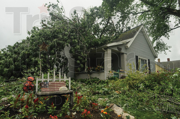 Tribune-Star/Rachel Keyes<br /> Destroyed: Wanda and Bill Hudgins house gets destroyed in Wednesday's storm as a tree in uprooted and crashes into the roof.