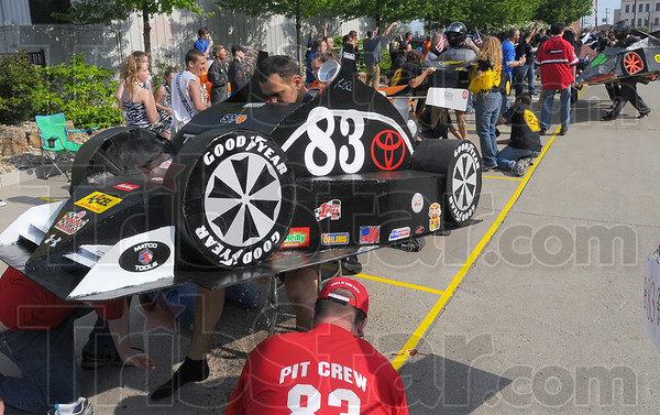 Tribune-Star/Jim Avelis<br /> Pit row: Each racer was required to make a pit stop. A change of shoes and a bottle of water and they were back on the track. Here the Toyota of Terre Haute entry gets serviced.