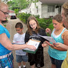 Tribune-Star/Jim Avelis<br /> Loading up: Gail Phillips, Sebastian Moats, Cheyenne Overton, Cheyenne Johnson and Patty Weaver load up on flyers to distribute in the Terre Town neighborhood Thursday evening.