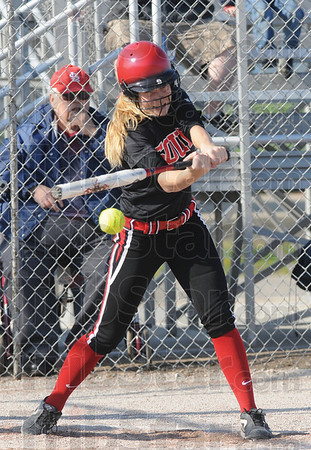 Tribune-Star/Rachel Keyes<br /> Grip it and rip it: Terre Haute South's Kelsey Marlow swings at a pitch in action Thursday against the Northview Knights.