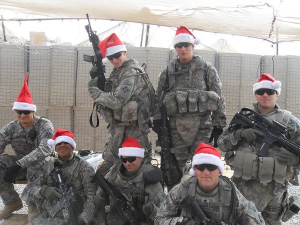 Submitted Photo<br /> Merry Christmas: Specialist Kyle Dite (top Left) is pictured with his Section on Christmas Day in Iraq.