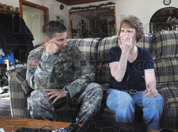 Tribune-Star/Rachel Keyes<br /> Emotional moment: Kathy Kerins (left) wipes a tear from her eye as she tells the story of her son Kyle Dite's (right) surprise home coming.