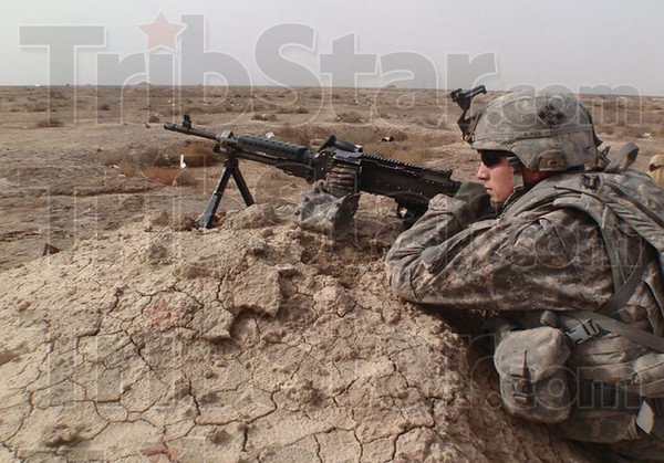 Submitted Photo<br /> Duty calls: Specialist Kyle Dite on Security Patrol in Iraq.