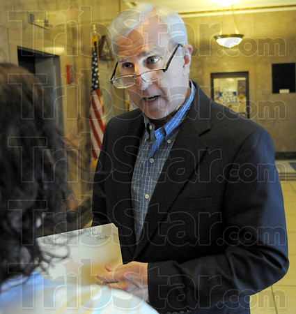 Defender: Public Defender John Kesler talks with a client in the hallway of City Hall prior to court Thurday morning.