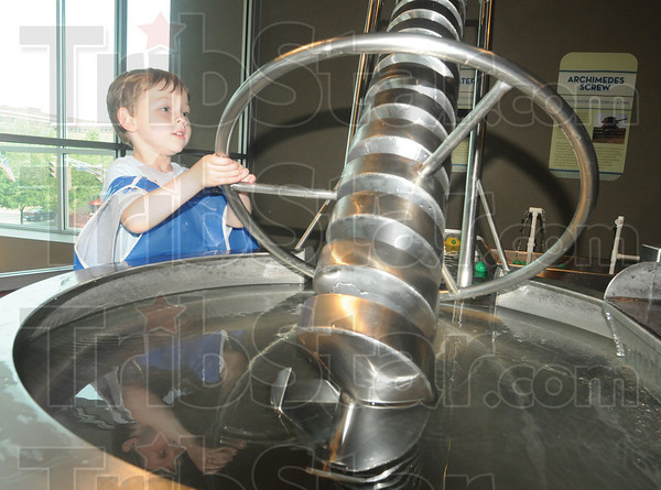 Tribune-Star/Rachel Keyes<br /> Learning from water: Four-year-old Sam Alderton interacts in the waterworks display at the Terre Haute Children's Museum.