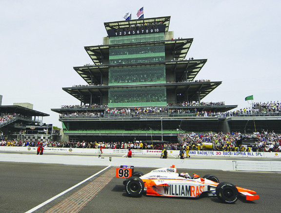 IndyCar driver Dan Wheldon, of England, crosses the finish line to win the Indianapolis 500 auto race at the Indianapolis Motor Speedway in Indianapolis, Sunday, May 29, 2011. (AP Photo/Darron Cummings)