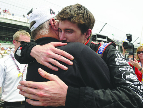 **CORRECTS TO JR HILDEBRAND** IndyCar driver  JR Hildebrand, right, is consoled  by Panther Racing owner John Barnes, after finishing second in the Indianapolis 500 auto race at the Indianapolis Motor Speedway in Indianapolis, Sunday, May 29, 2011. Hildebrand was one turn away from winning the Indianapolis 500 and within sight of the checkered flag when the 23-year-old rookie made the ultimate mistake. Leading by almost 4 seconds with a lap to go, Hildebrand skidded high into the wall on the final turn, and Dan Wheldon drove past to claim an improbable second Indy 500 win Sunday in his first race of the year. (AP Photo/Tom Strickland)