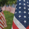 Tribune-Star/Rachel Keyes<br /> Red White Blue: American Flags draped across the front of St. Mark United Church of Christ in honor of soldiers who have served.