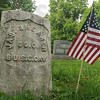 Tribune-Star/Rachel Keyes<br /> Honored: Someone took the time to place a flag near this 6th U.S. Calvary soldier's grave in Calvary Cemetery.