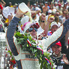 IndyCar driver Dan Wheldon, of England, douses himself with milk after winning the Indianapolis 500 auto race at the Indianapolis Motor Speedway in Indianapolis, Sunday, May 29, 2011. (AP Photo/Darron Cummings)