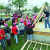 Tribune-Star/Jim Avelis<br /> Wall raising: Volunteers and habitat staff raise the first wall of the Stephens' home on Chase street.