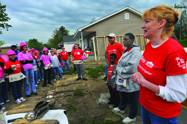 Tribune-Star/Jim Avelis<br /> Shelter from the storm: ............   Executive Director for Wabash Valley Habitat for Humanity, talks with volunteers just before the days' work begins. Saturdays' work will provide a home for Stephanie, Zion and Dario Stephens, to the right of........