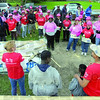 Tribune-Star/Jim Avelis<br /> Think pink: Habitat for Humanitys' Women Build day brought out the pink shirts and hard hats for volunteers who showed up to help build a home for Stephanie Stephens and her sons.