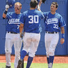 Tribune-Star/Rachel Keyes<br /> Hats off: Indiana State's Lucas Hileman (left) and Jeremy Lucas (right) tap hats with Jon Hedges (middle) after he hits a home run to put the Sycamores up by 4 in the six inning.