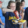 Catsup: South Putnam student Jessie McKean puts some catsup on her hamburger during Friday's Ag Expo.