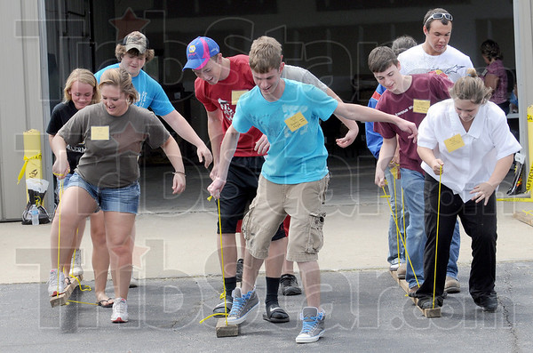 Teamwork: Groups of area ag students participate in a teamwork related event at the Ivy Tech Ag Expo Friday.