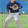Tribune-Star/Jim Avelis<br /> Stopped short: Terre Haute North short stop Cody Gardner stops a Mooresville hit.
