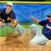 Tribune-Star/Jim Avelis<br /> In safe: Dalton hathaway slides safely into second base before Mooresvilles' Brandon Smalling gets the throw.