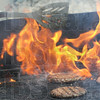 Flame broiled: Ivy Tech employee Barbara Kristler prepares hamburgers for Ag Expo participants Friday afternoon.