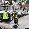 Convoy: Sheriff's deputies control traffic in West Terre Haute as a convoy of utility vehicles arrives to help crews restore power.