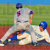 Tribune-Star/Jim Avelis<br /> Blocked: Jordan Pearson is tagged out trying to steal second base as Evansville shortstop Eric Stamets(8) blocks the bag with his foot.